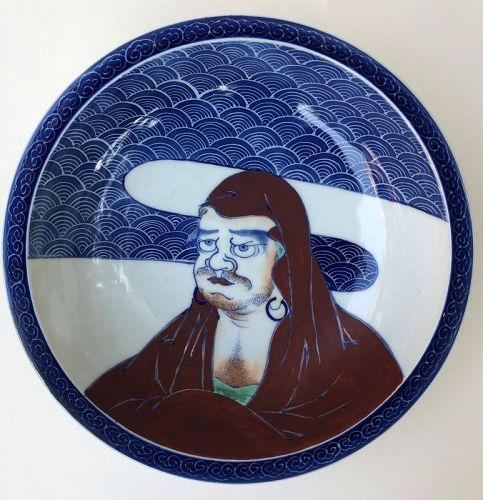 A Japanese porcelain Nabeshima style bowl with Daruma