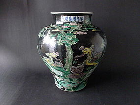 A richly decorated 19th cent. Famille Noire Peacock jar