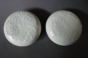 A pair of Song Dynasty moulded Qingbai covered boxes