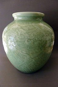 A beautiful, large, moulded Celadon glazed Dragon Jar