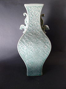 A very beautiful, moulded, bluegreen Celadon vase