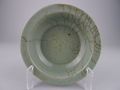 A very rare and important black-paste Guan-type Longquan dish