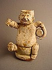 Han Dynasty ?? story teller with a drum .