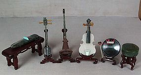 6 Chinese jade & hardstone musical instruments