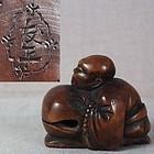 19c netsuke MONK with Buddhist gong by TOMOMASA