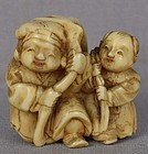 19c netsuke DAIKOKU with BOY & gifts