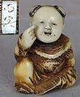 19c staghorn netsuke BEKKAKO BOY, oni mask by MEIUN ex ROYAL
