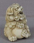 Early 19c Kyoto school netsuke SHISHI with ball