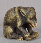 19c staghorn netsuke WOLF with deer leg