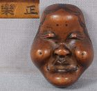 19c shunga netsuke OKAME mask by SHORAKU from FHC collection of 1923