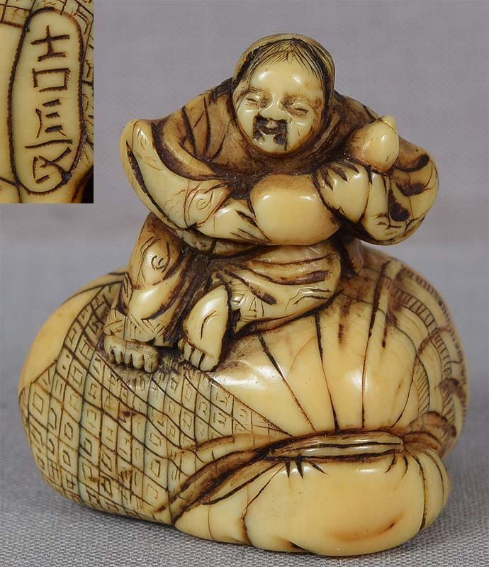 18c netsuke BOY with gourd on bag by YOSHINAGA
