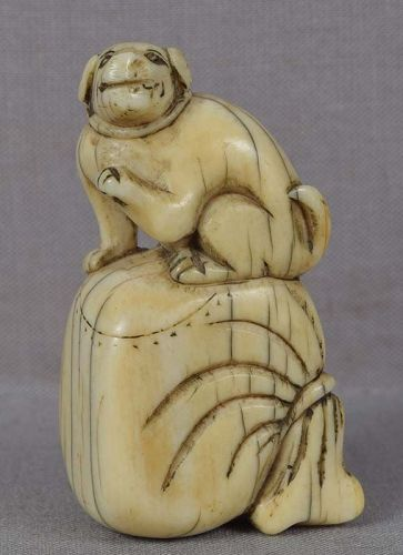 18c netsuke DOG ON BAG