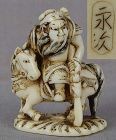 19c netsuke KWANYU God of War on horse by NAGATSUGU