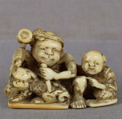 18c netsuke boy & SCULPTOR carving shishi