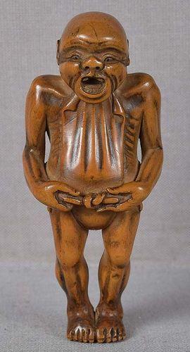 19c netsuke MAN TYING loincloth FUNDOSHI ex Greenfield