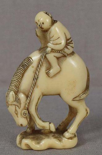 Early 19c netsuke SLEEPER on HORSE