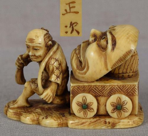 19c netsuke MAN with mask on cart by MASATSUGU