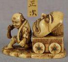 19c netsuke MAN with mask on cart by MASATSUGU