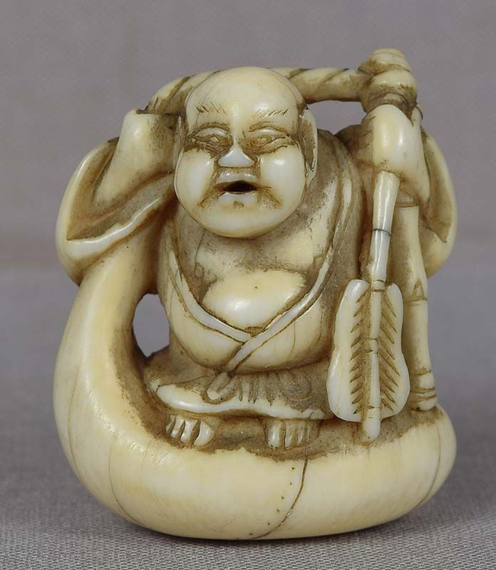 Early 19c netsuke HOTEI on bag