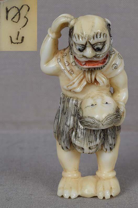 19c marine netsuke ONI with Okame mask by MEIZAN