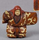 19th century small lacquered netsuke of an actor in a shojo dancer wit
