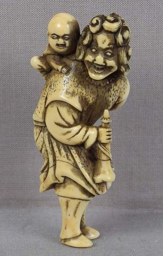 18c netsuke DUTCHMAN with child & trumpet
