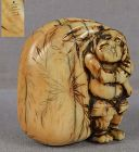 Early 19c netsuke ONI with treasure bag by NOBUYUKI