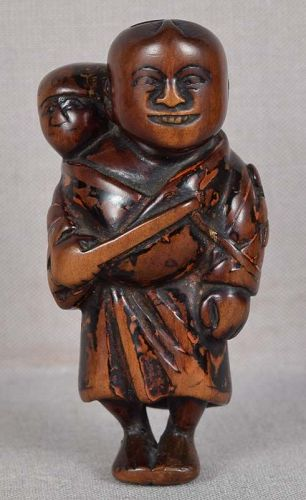 Early 19c Negoro lacquer netsuke MAN boy DRAGONFLY