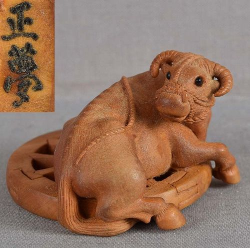 Netsuke BUFFALO on wheel by MASAYUME