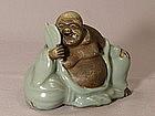 Japanese Kutani Celadon figurine of Hotei Circa 1910