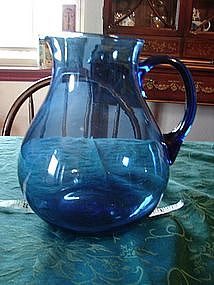 Huge blue pitcher.