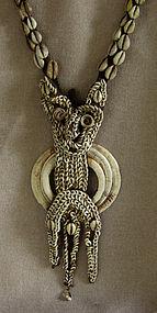 Kara�wut Boar's tusk, shell ornament Papua New Guinea