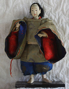 Edo period Japanese small standing retainer doll