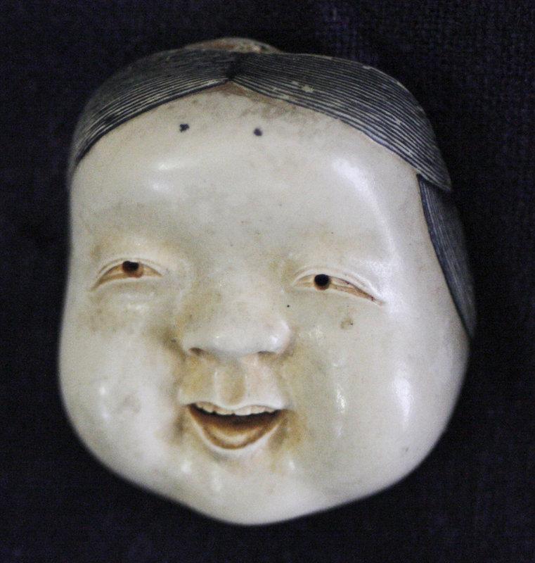 Meiji netsuke Noh theater mask of Okame