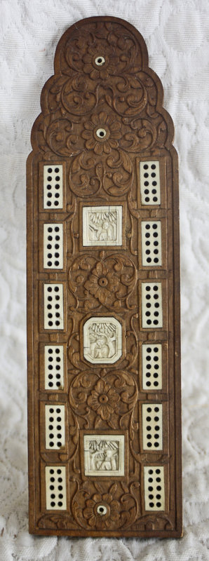 Ornately carved Chinese wood cribbage board with bone/ivory insets