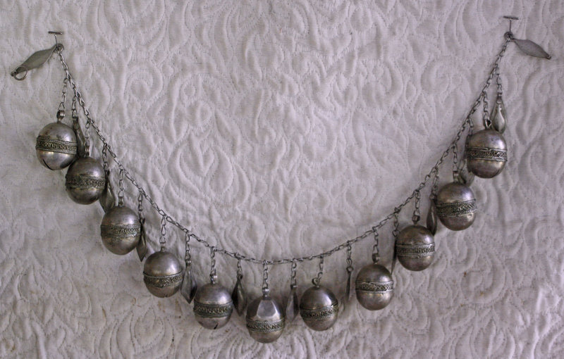 large necklace of Bells and symbolic lotus seeds