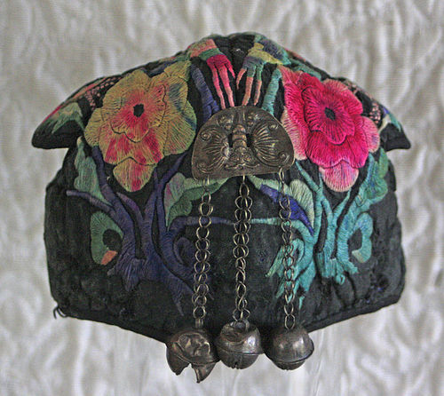 Antique Chinese Miao Ethnic embroidered baby hat with silver buddhas