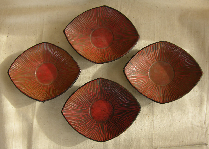 Set of 4 antique Chinese hand carved wood tea saucers