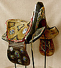Antique Tibetan saddle wth cloisonne detail and rug pad