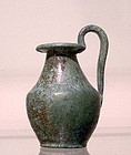 AN ANCIENT GREEK BRONZE JUG