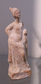 A LARGE GREEK TERRACOTTA STANDING FEMALE FIGURE