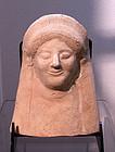 AN ANCIENT GREEK TERRACOTTA PROTOME OF A GODDESS