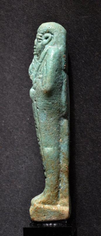 AN ANCIENT EGYPTIAN FAIENCE SHABTI