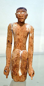 AN ANCIENT EGYPTIAN WOOD FIGURE OF A MAN