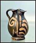 AN ANCIENT APULIAN XENON WARE MINIATURE OINOCHOE