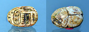 AN EGYPTIAN STEATITE SCARAB WITH TUTHMOSE III CARTOUCHE