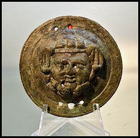 AN ANCIENT ROMAN BRONZE ROUNDEL OF ZEUS AMMON