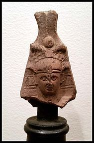 AN EGYPTIAN TERRACOTTTA HEAD OF A PHARAOH