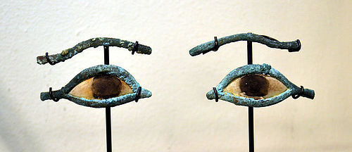 AN ANCIENT EGYPTIAN PAIR OF BRONZE EYES