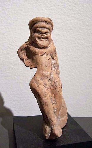 AN ANCIENT GREEK TERRACOTTA FIGURE OF A COMIC ACTOR